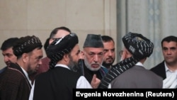 Former Afghan President Hamid Karzai (center) talking to the Taliban officials in Moscow on May 28.
