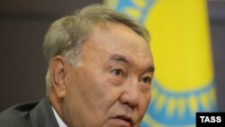 Kazakh President Nursultan Nazarbaev listens to Russian President during a meeting in Sochi on August 16.