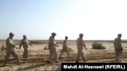 وحدة شرطة عراقية خاصة تبحث عن ألغام في الناصرية