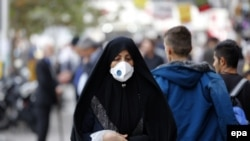 An Iranian woman wearing a mask in a street in Tehran, November 16, 2016.