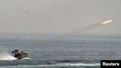 An Iranian boat fires a missile as it takes part in a naval war game in the Persian Gulf and the Strait of Hormuz.