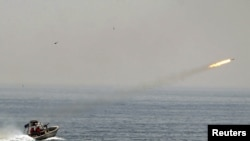An Iranian boat fires a missile during naval war games in the Persian Gulf and the Strait of Hormuz in April 2010.