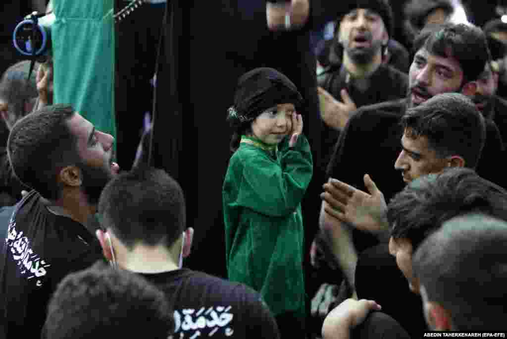 People are encouraged to cry or weep during the ceremonies to show their sadness. Children were among the mourners in Tehran on August 30.