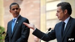 "French President Nicolas Sarkozy (left) told his U.S. counterpart, Barack Obama, that France is ""not waging war against Afghanistan."""