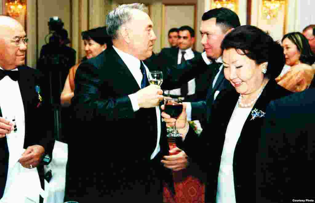 Aliev's father, Mukhtar (left), President Nursultan Nazarbaev, Rakhat Aliev, and Sara Nazarbaeva in a photo predating the criminal charges. While Aliev remained in Austria, Kazakh authorities unsuccessfully requested his extradition. Kazakh officials later added new charges of plotting o overthrow the government and organizing the murder of an opposition leader in 2006.