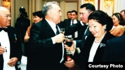 The Nazarbaev and Aliev families in happier times: Mukhtar Aliev, Nursultan Nazarbaev, Rakhat Aliev, and the president's wife, Sara Nazarbaeva (left to right, from the Aliev family archive)