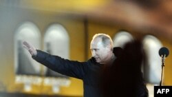 Russia -- Vladimir Putin addresses his supporters during a rally on Manezh Square just outside the Kremlin in Moscow, 04Mar2012