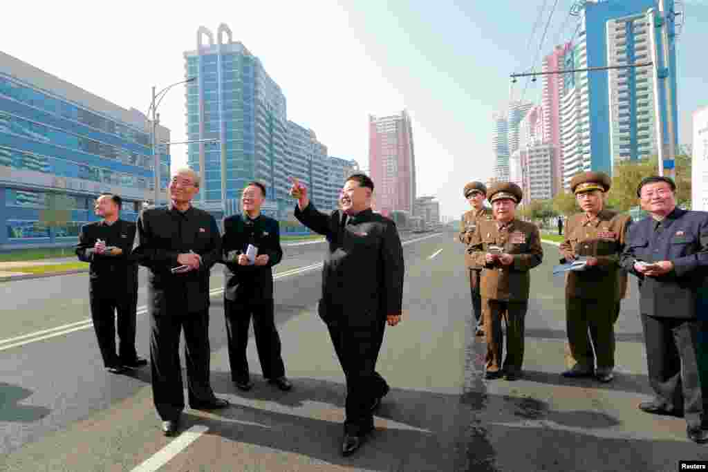 North Korean leader Kim Jong Un, here strolling among freshly completed apartment blocks, has slipped some reforms into his nation's moribund economy.