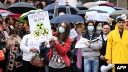 Environmental activists protest in front of the U.S. Embassy in Tirana on November 12.
