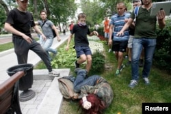 "Antigay youths kick a gay-rights activist during a protest against Russia's homosexual ""propaganda"" law in Moscow in June 2013."