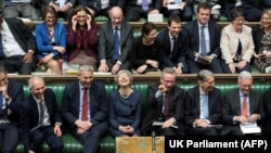 В парламенте Великобритании.