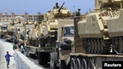 Egyptian forces prepare to deploy to the Sinai Penninsula in the city of Rafah, some 350 kilometers northeast of Cairo, on August 9.