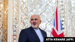 Iran's Foreign Minister Mohammad Javad Zarif waits to meet his British counterpart upon the latter's arrival in the capital Tehran on November 19, 2018.