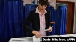 Laura Codruta Koevesi casts her ballot for the European elections at a polling station in Bucharest on May 26.