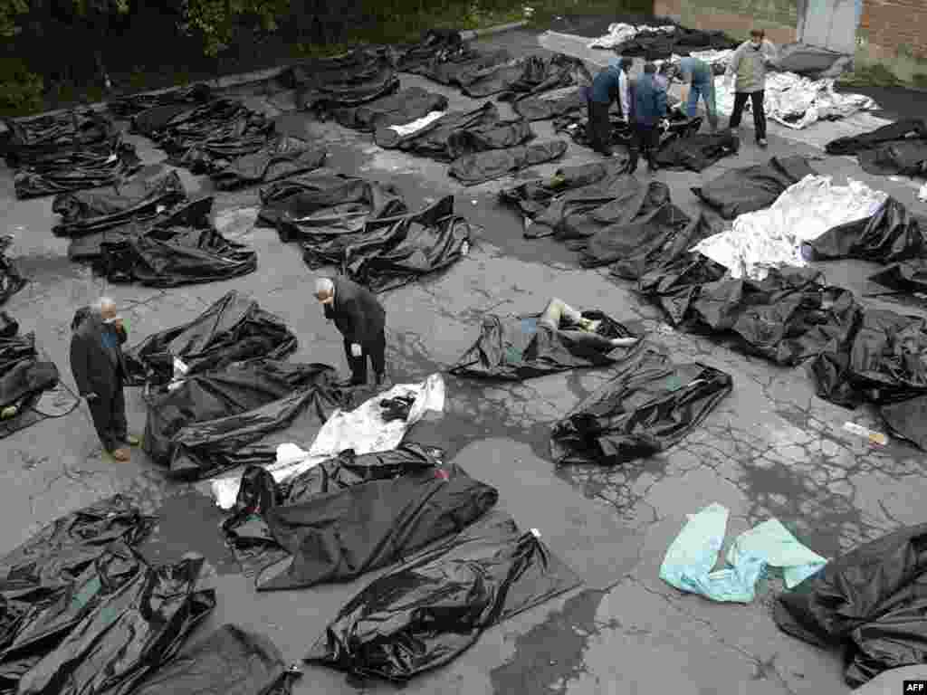 Relatives try to identify the bodies of victims outside a morgue in Vladikavkaz.