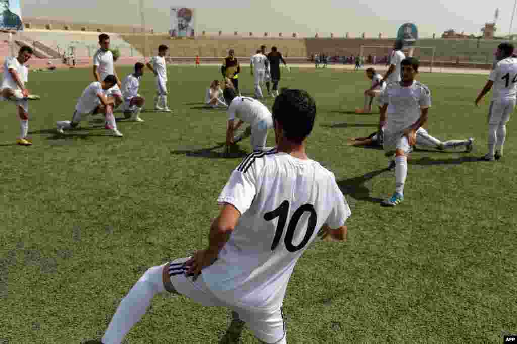 Afghan pro football players training at a Kabul stadium on September 2.