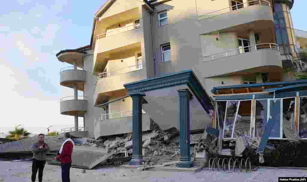A large residential building in Durres that appears to have collapsed its first floor.