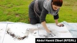 رسامة في معرض بأربيل في الهواء الطلق دعماً للبيشمركه