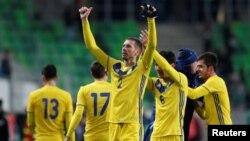 Казахстанские футболисты после победы в товарищеском матче со сборной Венгрии. Будапешт, 23 марта 2018 года.