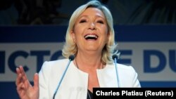 French far-right leader Marine Le Pen reacts after her party's strong showing in EU parliamentary elections on May 26.