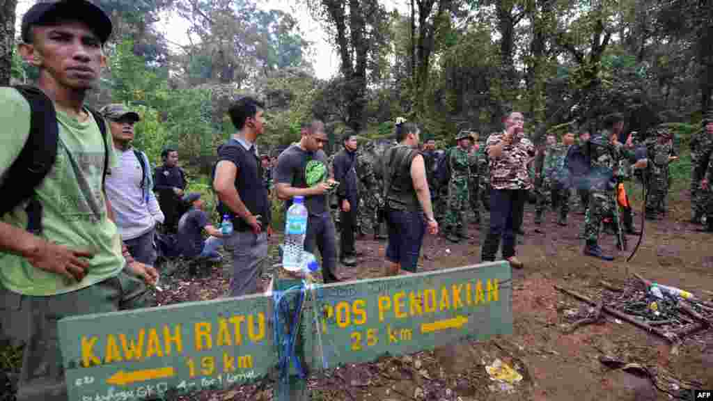Soldiers and members of a search-and-rescue team rushed to the crash site in hopes that some of the 50 or so passengers and crew survived.