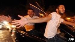 Оппозиция жақтастарының сайлаудан кейінгі қуанышы. Тбилиси, 1 қазан 2012 жыл.