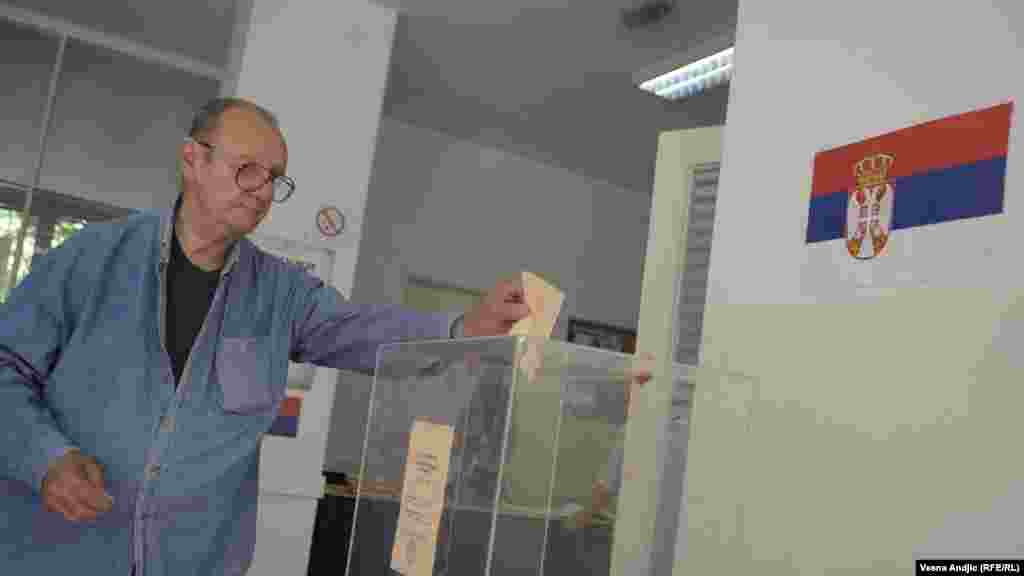 A voter casts his ballot in Belgrade in the May 20 runoff vote.