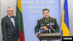 Ukrainian Defense Minister Stepan Poltorak (right) and Lithuanian counterpart Juozas Olekas appear in Kyiv in April.