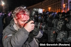 Garanich at work after being hit by a policeman in Kyiv.