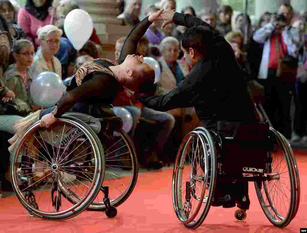 Handicapped dancers perform on the red carpet during the 49th Karlovy Vary International Film Festival, in Karlovy Vary, Xzech Republic, on July 9. (epa/Filip Singer)