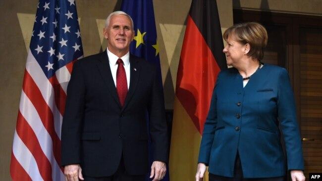 Neophodno zajedničko delovanje: Majk Pens i Angela Merkel