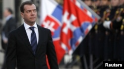 Russian President Dmitry Medvedev walks past a guard of honor upon his arrival in Bratislava.