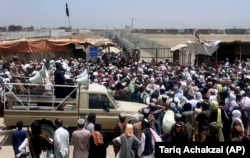 Those stranded at the border move to cross into Afghanistan from the crossing point at Chaman on July 17.
