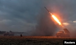 Ukrainian soldiers launch a Grad rocket toward pro-Russian separatist forces outside Debaltseve on February 8.