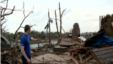 Survivor Ricky Stover surveys damage from the May 20 tornado in Moore, Oklahoma.