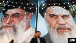 Iranian President Mahmud Ahmadinejad speaks in front of looming posters of Supreme Leader Ayatollah Ali Khamenei (left) and revolutionary leader Ayatollah Ruhollah Khomeini in Tehran. (file photo)