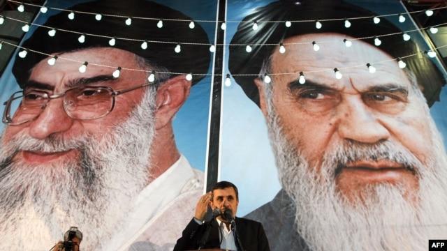 Iranian President Mahmud Ahmadinejad speaks in front of looming posters of Supreme Leader Ayatollah Ali Khamenei (left) and revolutionary leader Ayatollah Ruhollah Khomeini in Tehran. (file photo)