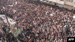 Syrian police used tear gas to disperse some 70,000 people who took to the streets of Homs as Arab observers visited on December 27.