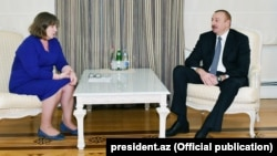 Azerbaijani President Ilham Aliyev (right) received European Parliament rapporteur Norica Nicolai in Baku in April.