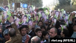 Hundreds demonstrate on February 2 against the killing of a kidnapped child in Afghanistan's Herat Province.