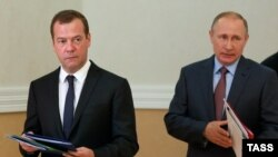 Russian President Vladimir Putin (right) and Prime Minister Dmitry Medvedev arrive at a Security Council session held in Sevastopol, Crimea, on August 19.