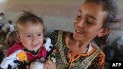 ایزدیهای عراق ساکن سنجار که ازد تابستان گذشته و با حمله «حکومت اسلامی» در کوهها آواره شده بودند، با رسیدن نیروهای پیشمرگه به شادی پرداختهاند