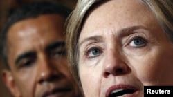 АҚШ президенті Барак Обама мен мемлекеттік хатшы Хиллари Клинтон.