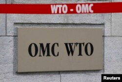 Знак ВТО на здании штаб-квартиры организации в Женеве