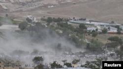 Smoke rises from the site of a suicide attack after a blast in Kabul on June 3.