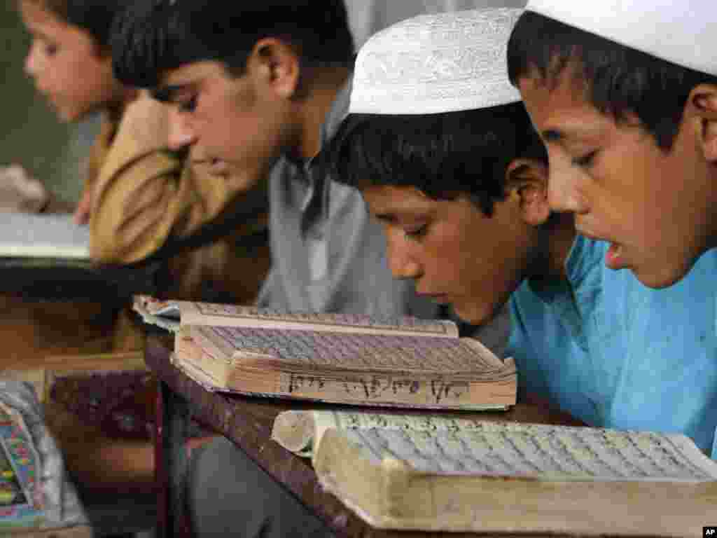 Afghan boys read the Koran at a mosque in the city of Jalalabad, the provincial capital of Nangarhar Province, east of Kabul. Photo by Rahmat Gul for AP