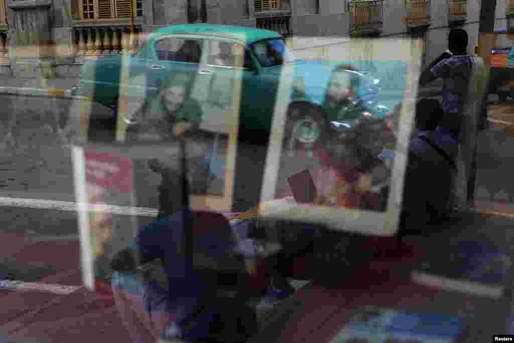 Portraits of the late Cuban leader Fidel Castro are reflected in a window in Matanzas. (Reuters/Ivan Alvarado)