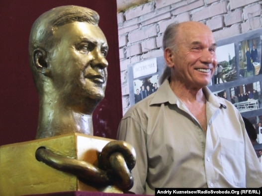 Mykola Shmatko and his sculpture titled 'Among Emperors'