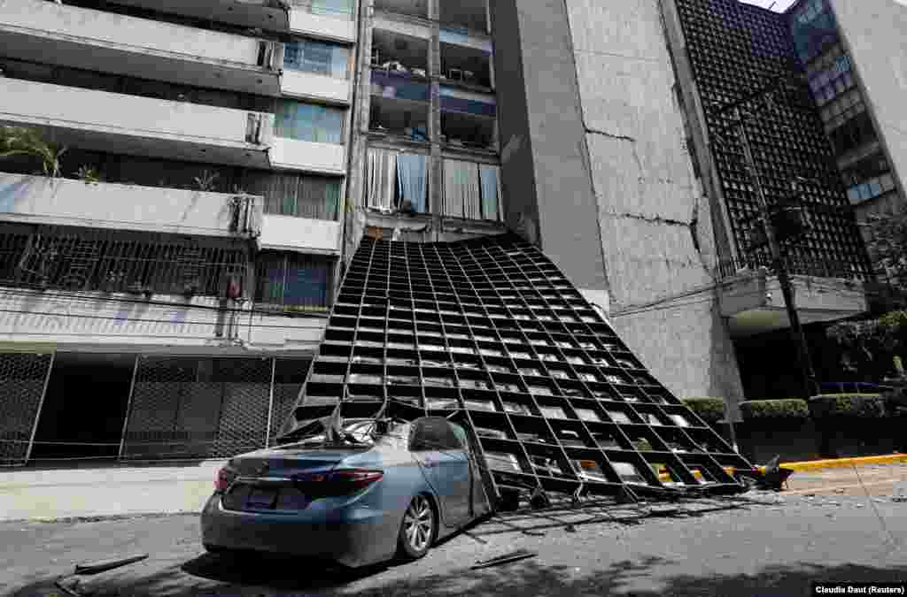 A damaged car is seen outside a building after a major earthquake in Mexico City on September 19. (Reuters/Claudia Daut)
