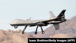 File photo-An MQ-9 Reaper remotely piloted aircraft (RPA) flies by during a training mission at Creech Air Force Base.